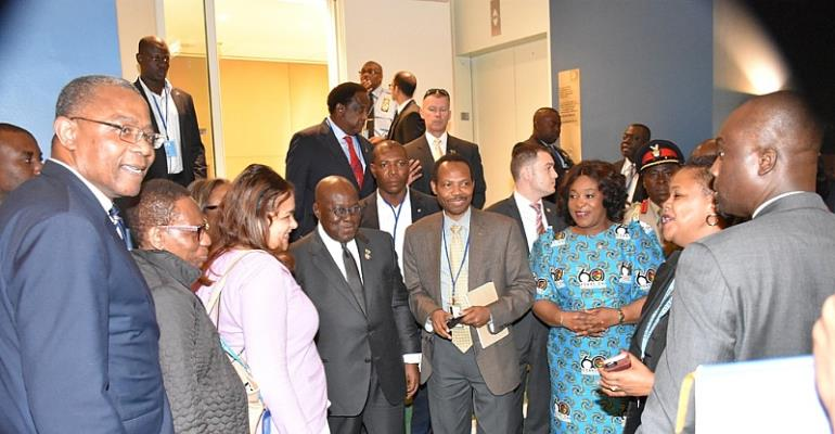 President in a group picture with some members of the Ghanaian UN Social Recreation Club who congratulated him after his address.