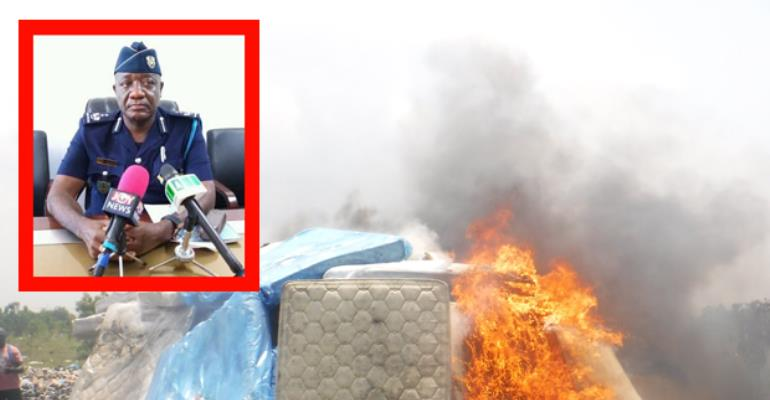 Some of the seized mattresses on fire. INSET: Mr. Lawrence Anang addressing the media
