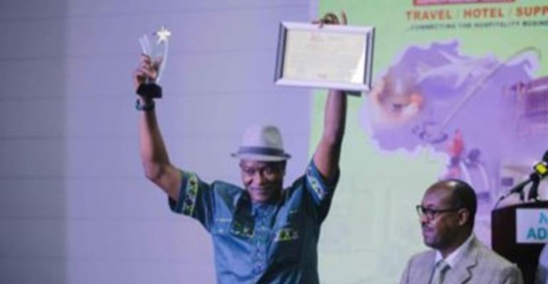 Ikechi Uko displaying his awards