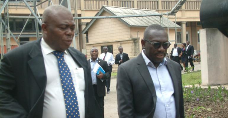 Asamoah Boateng left and the Acting MD of Ghana Post