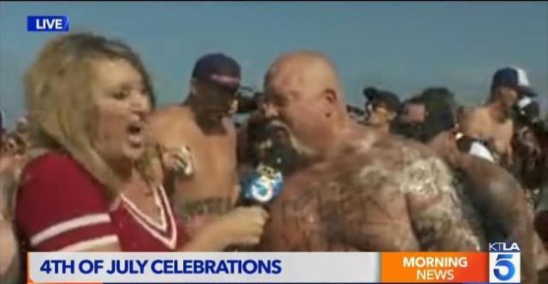 California reporter sprayed with vomit by a drunken reveler on a live report.