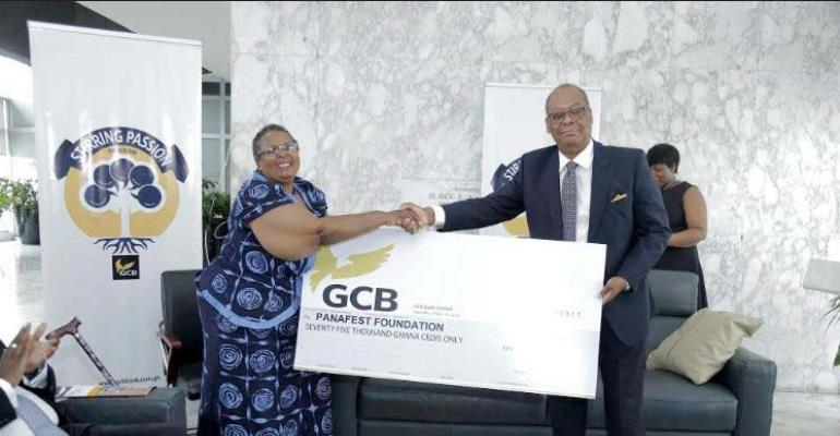 Anselm Ray Sowah presenting the cheque to Prof Esi Sutherland-Addy