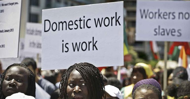 Migrant domestic workers march at Beirut's seaside and hold banners demanding basic labor rights as Lebanese workers during a 2013 protest. The recent beating of two Kenyan domestic workers in Lebanon highlights the ongoing problem of violence against Black women in Arab countries. (Photo: Hussein Malla/AP)