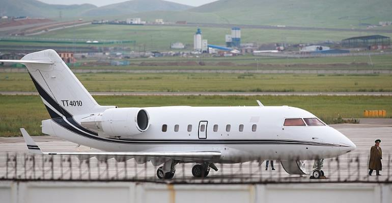 A passenger jet believed to be operated by the Turkish Air Force at the airport in Ulan Bator, Mongolia, on Friday. The Mongolian authorities grounded a Turkish jet amid protests over the abduction of a Turkish educator.CreditByambasuren Byamba-Ochir/Agence France-Presse — Getty Images