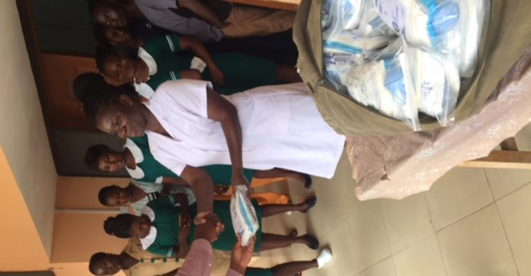 Madam Lizbeth Ansah Midwife receives maternity kits on behalf of the  Elmina Urban Health Centre  from Prof. Ulzen