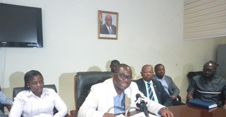 Sarfo Mensah with his team addressing the media yesterday at his office