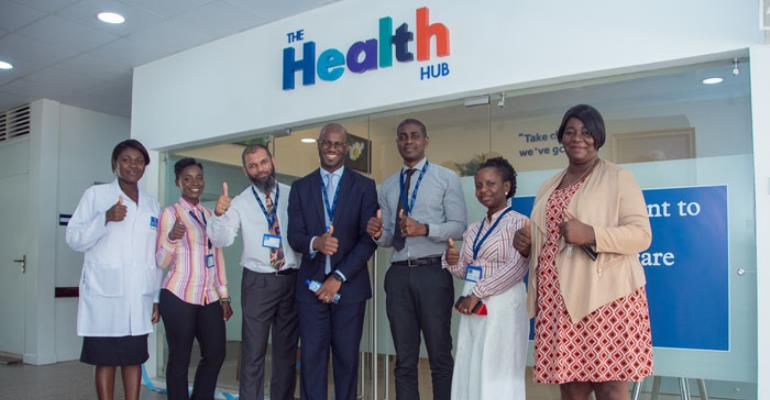 Dr. Elikem Tamaklo in front of the health hub with staff of Nyaho Medical Centre