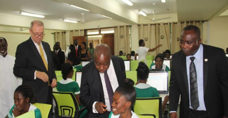 Kwaku Agyeman-Manu, Felix Nyante and Ambassador Ron Strikker inspecting the exams