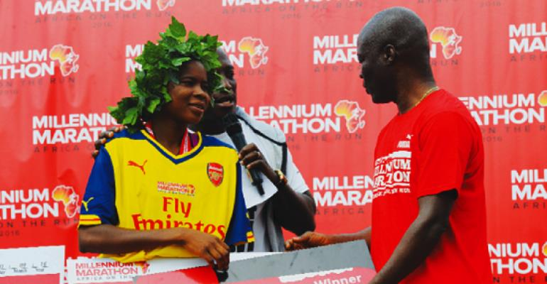 Youth and Sports Minister, Nii Lantey Vanderpuye presenting Sakat Lariba with dummy keys to her Peugeot car as first runner-up of the women's race.