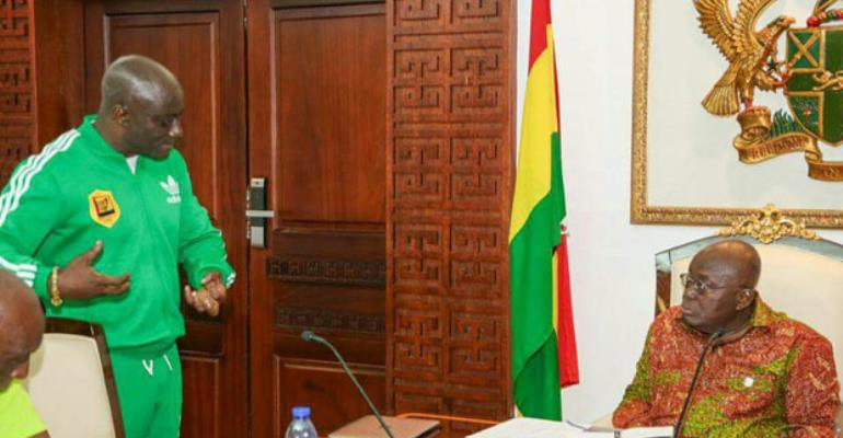 Reks (L) explaining a point to Nana Addo
