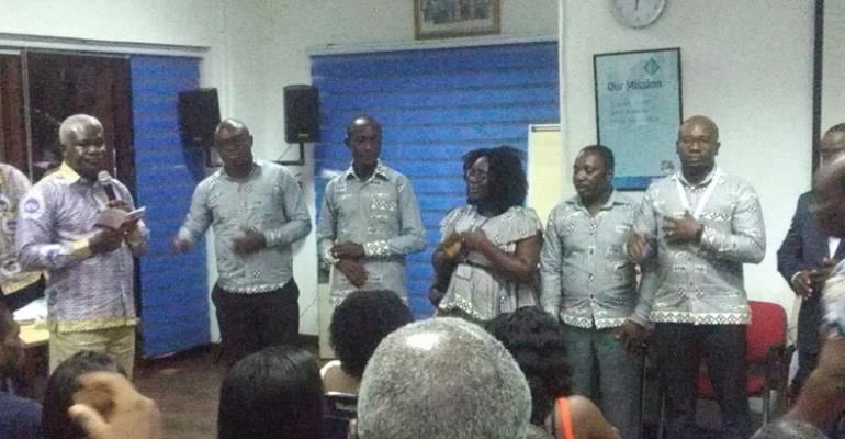 Solomon Kotei (left) swears in the new union executives.