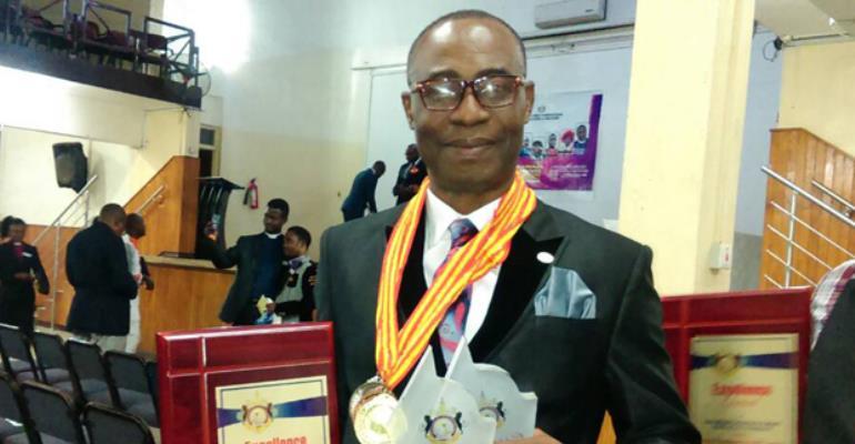 Dr Brown Osei Konadu-Yiadom after receiving the award