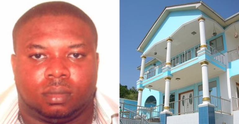 Jailed: Maurice Asola Fadola with the luxurious mansion funded by his crimes