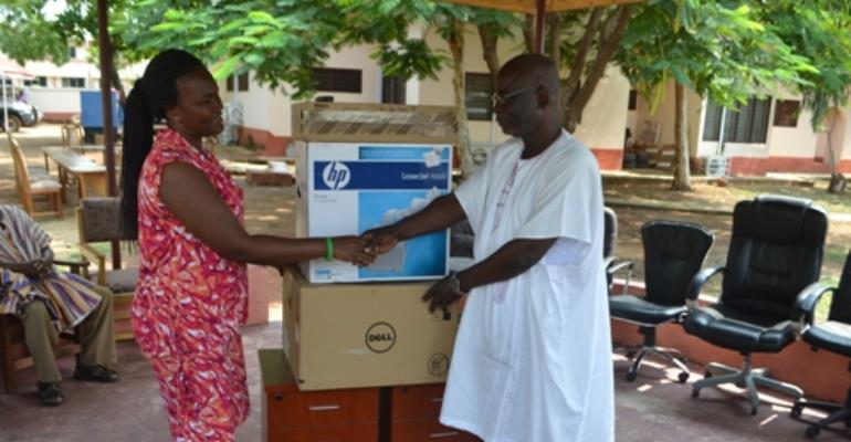 Mrs. Millicent Kaleem (left) the Manager for Enterprise and Leadership Development Program at Camfed presenting a cabinet and computer accessories to Alhaji Abdul-Rahaman Saani (right) the Tamale Metropolitan Educational Director yesterday in Accra