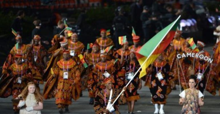 Cameroon's flagbearer Annabel Laure Ali (C) leads her delegation during the opening ceremony of the London 2012 Olympics.  By Gabriel Bouys (AFP)