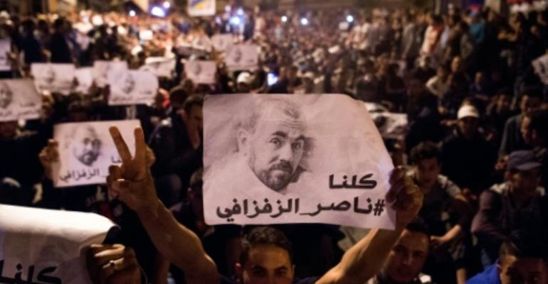 The Al-Hirak al-Shaabi protests took hold of Morocco's northern Rif region and the movement's leader Nasser Zafzafi (posters) and three others received sentences of 20 years for threatening the security of the state.  By FADEL SENNA (AFP/File)
