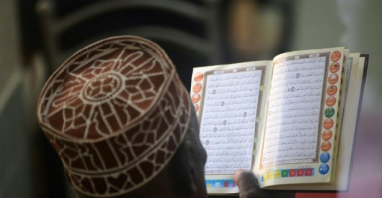 The Koran and accompanying hadiths form the basis of Sharia law.  By SIMON MAINA (AFP/File)