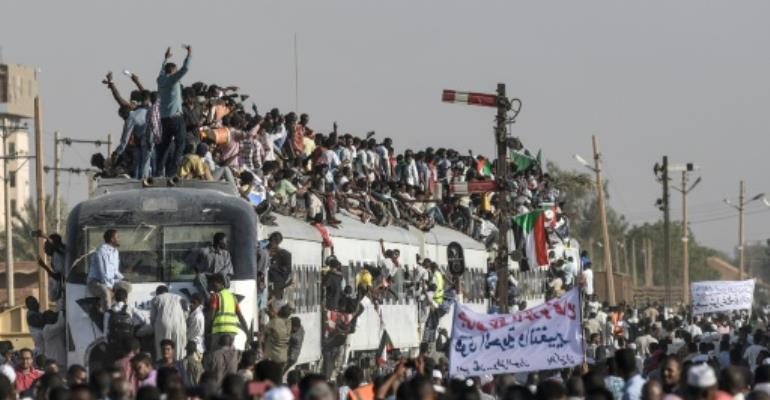 Protest train rolls into Khartoum as US urges civilian handover