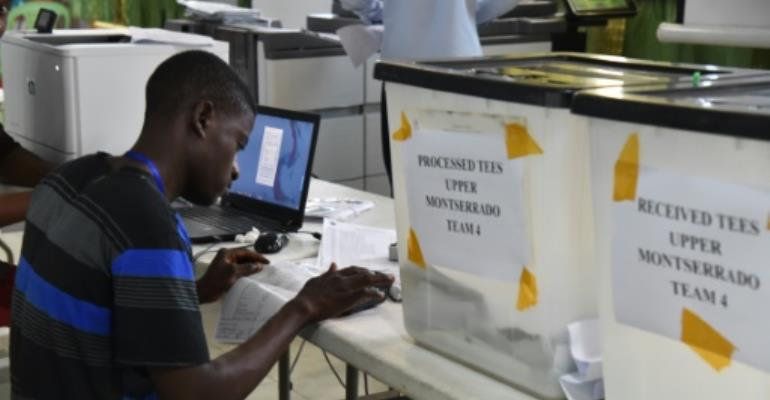 The results of Liberia's presidential elections have been delayed after hiccups on polling day, which included long queues at ballot stations and misdirections to voters. The election is a vital barometer of the country's stability.  By ISSOUF SANOGO (AFP)