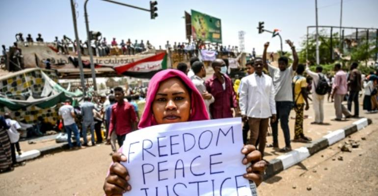 Protestors throng Khartoum a week after Bashir ouster