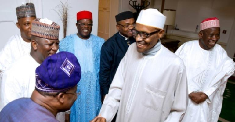 This handout photograph taken and released by the Nigerian government last month shows President Muhammadu Buhari (2R) receiving visitors in London where he has been undergoing treatment for an undisclosed illness for more than three months..  By BAYO OMOBORIOWO (NIGERIA STATE HOUSE/AFP)