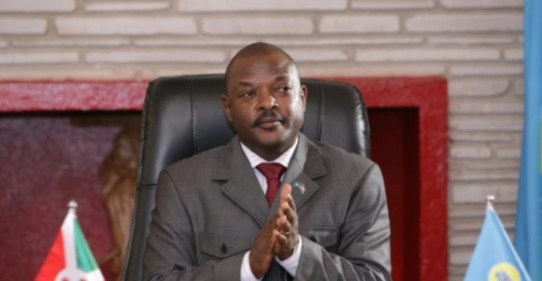 Three teenage girls had faced up to five years in prison for insulting Burundi President Pierre Nkurunziza (pictured June 2018) by drawing on his picture in their textbooks.  By STR (AFP/File)