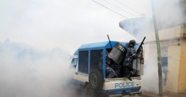 Togo police drive through smoke during clashes with protesters on August 22.  By Emile Kouton (AFP/File)