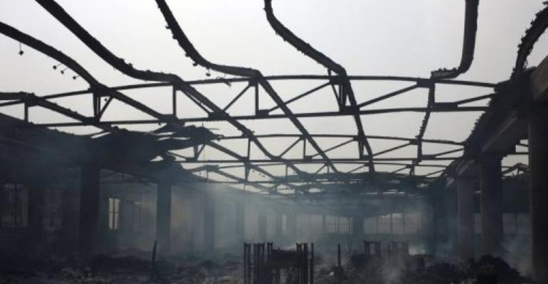 The steel frames of sewing machines are seen Lome's Grand Marche on January 12, 2013 after it was engulfed in flames.  By Daniel Hayduk (AFP/File)
