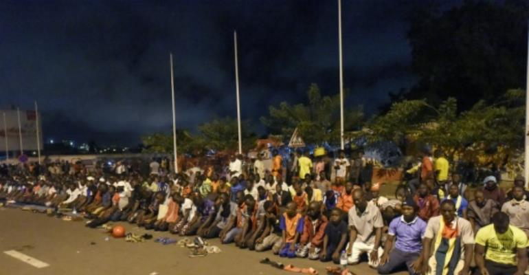Togo's opposition supporters, seen here praying at an all-night vigil, are putting huge pressure on the government to enact constitutional reform.  By PIUS UTOMI EKPEI (AFP/File)