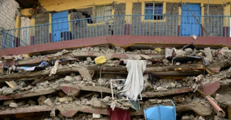 Two people have died after being pulled from the collapsed building in Nairobi but the search goes on for other survivors.  By John MUCHUCHA (AFP/File)