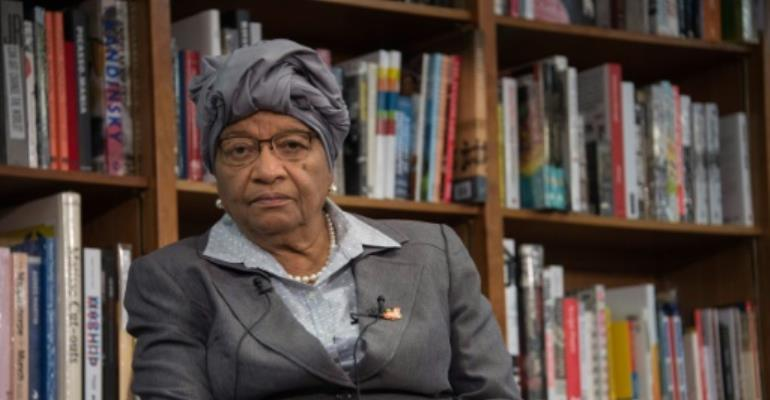 Twenty candidates are vying to succeed Liberia's president, 2011 Nobel winner Ellen Johnson Sirleaf, who is stepping down after 12 years at the helm.  By NICHOLAS KAMM (AFP/File)