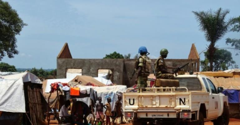 UN peacekeepers from Gabon patrol the town of Bria in Central African Republic, where most of the country's residents live in poverty, on June 12, 2017.  By SABER JENDOUBI (AFP)