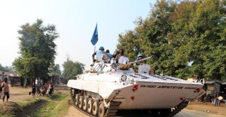 This picture taken on August 4, 2013 shows peacekeepers from the MONUSCO mission in the Democratic Republic of Congo patrolling the town of Kiwanja.  By Stephanie Aglietti (AFP/File)