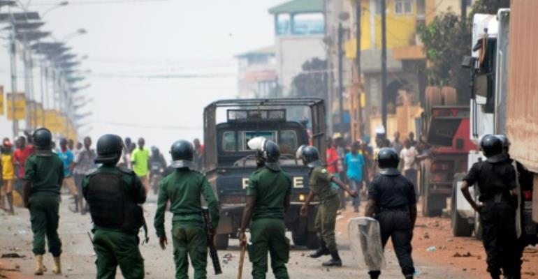 Unrest following Guinea's disputed February 4 election led to the deaths of at least 10 people.  By CELLOU BINANI (AFP/File)