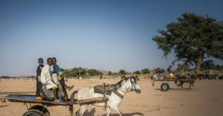 Water vendors in the arid Ouaddai district of Chad travel back and forth between meagre supplies and needy folk in town.  By Amaury HAUCHARD (AFP/File)
