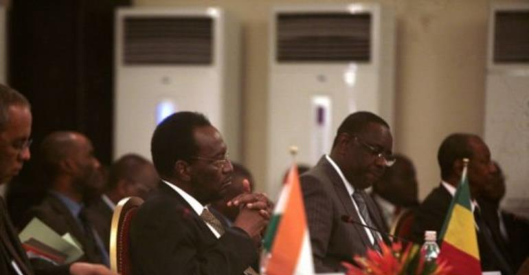 Mali's interim president Dioncouda Traore (left) and Senegalese President Macky Sall at the meeting.  By Herve Sevi (AFP)