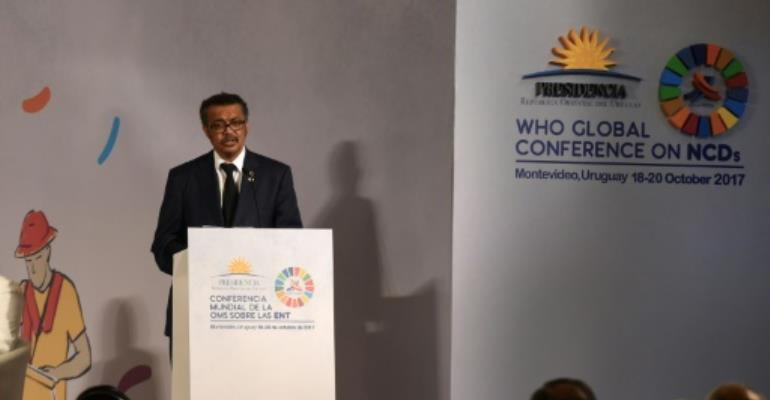 WHO head Tedros Adhanom Ghebreyesus had praised Zimbabwe's health coverage -- but announced a rethink after critics observed its president tends to get his treatment abroad.  By MIGUEL ROJO (AFP)