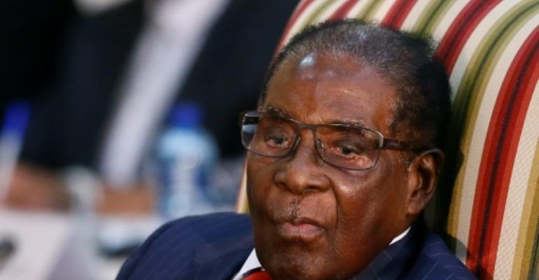 Zimbabwe President Robert Mugabe has hinted at a cabinet reshuffle.  By Phill Magakoe (AFP/File)