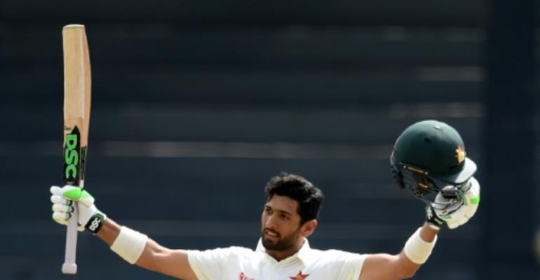 Zimbabwe's Sikandar Raza celebrates after scoring a century on the fourth day of their one-off Test match against Sri Lanka, at the R Premadasa Cricket Stadium in Colombo, on July 17, 2017.  By ISHARA S. KODIKARA (AFP)