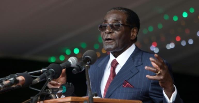 Zimbabwe's President Robert Mugabe delivers a speech during celebrations marking his birthday in February 2016.  By Jekesai Njikizana (AFP/File)