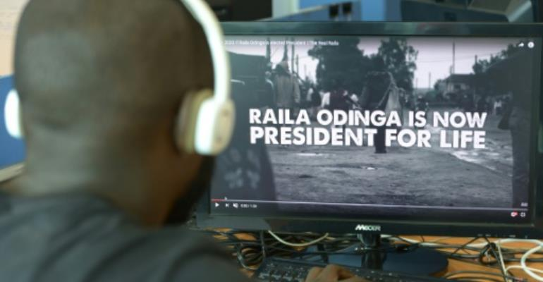 A man watches a hard-hitting online campaign ad just weeks before national elections, in Nairobi on July 13, 2017.  By SIMON MAINA (AFP)
