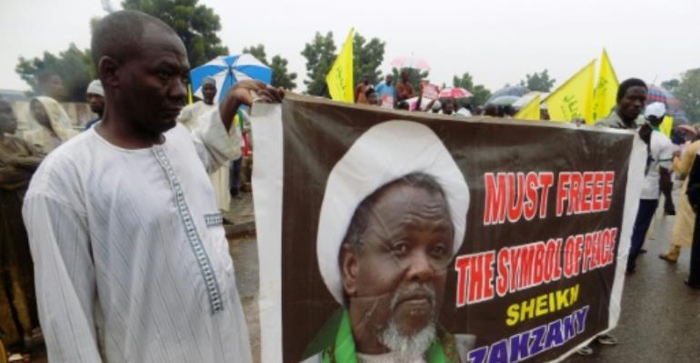 A banner with the image of pro-Iranian Shiite Muslim cleric Ibrahim Zakzaky, who who has been held in custody for more than two years in Nigeria.  By Aminu Abubakar (AFP/File)