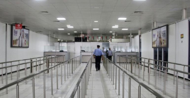 A Libyan policeman walks in the empty Mitiga International Airport in September last year, when the facility was closed by an earlier round of militia clashes.  By Mahmud TURKIA (AFP/File)