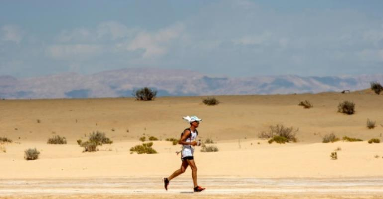 A runner competes in the Ultra Mirage El Djerid ultra-marathon in the southwestern Tunisian desert on October 7, 2017.  By AMINE LANDOULSI (AFP)