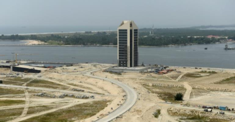 A skyscraper under construction at Eko Atlantic City, Lagos, billed as the largest real estate project in Africa, where frenetic construction has slowed to a snail's pace.  By Pius Utomi Ekpei (AFP)