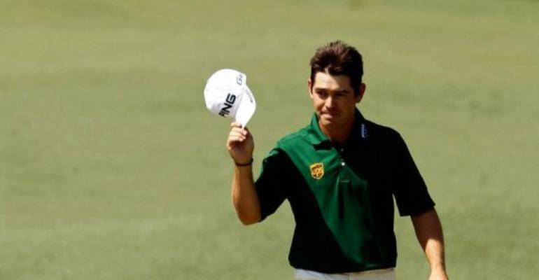 Louis Oosthuizen of South Africa smiles after making an albatross at the Masters.  By Streeter Lecka (AFP/Getty Images)