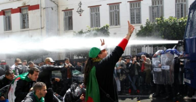 Algerian security forces used water cannon against students protesting in Algiers.  By STRINGER (AFP)
