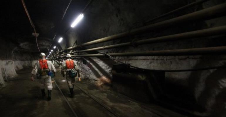 Mine workers walk in a platinum mine in South Africa.  By Paballo Thekiso (AFP/File)