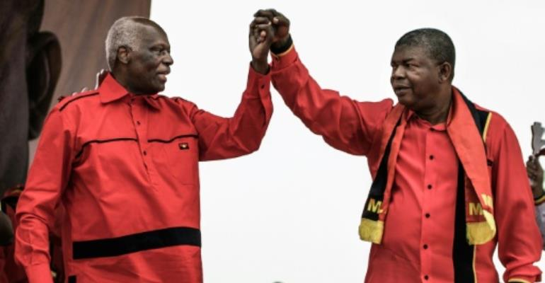 Angolan President Jose Eduardo dos Santos (L), pictured in August 2017, is set to hand over power to former defence minister Joao Lourenco (R) after Angola's Constitutional court upheld Lourenco's election.  By MARCO LONGARI (AFP/File)