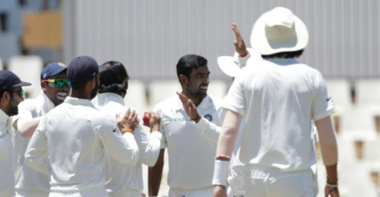 Bowler Ravichandran Ashwin (C) celebrates the dismissal of South African batsman Dean Elgar.  By GIANLUIGI GUERCIA (AFP)
